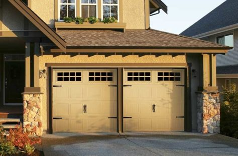Exterior photo of Residential Steel Carriage Style Garage Door