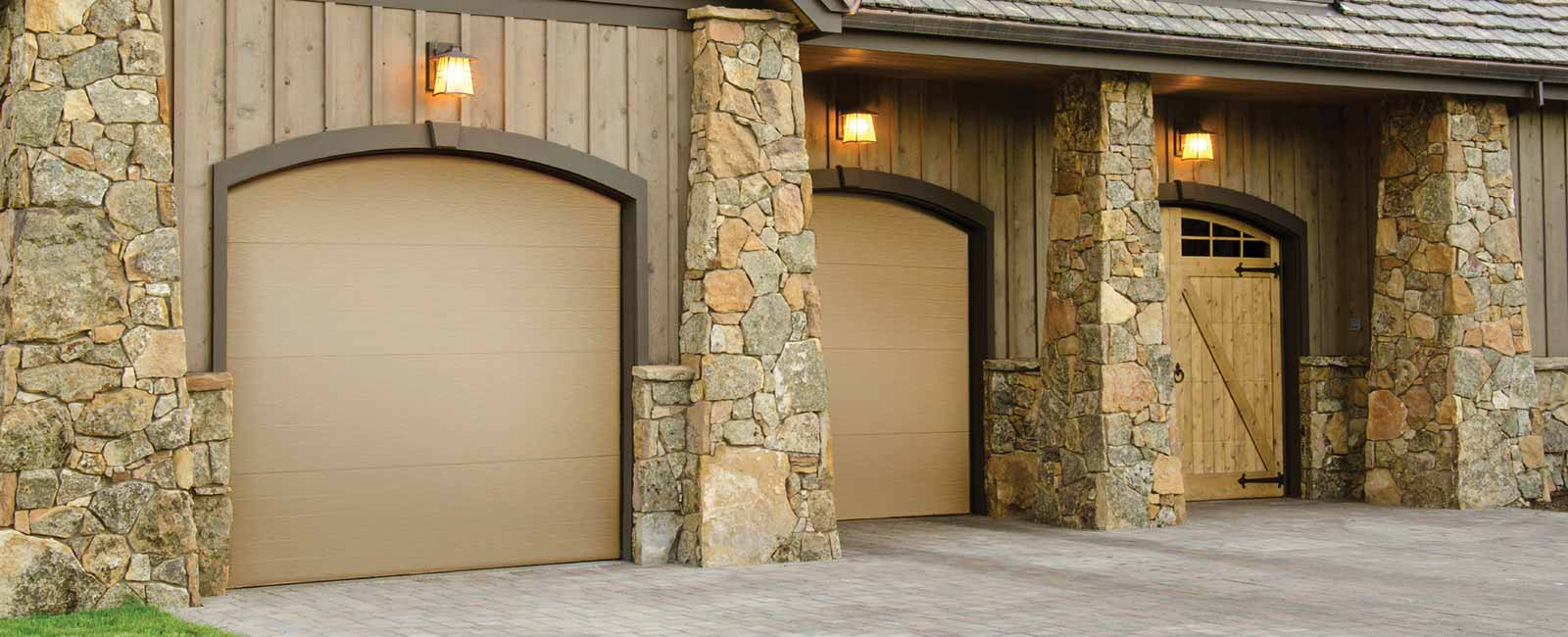 three single-car flush panel garage doors