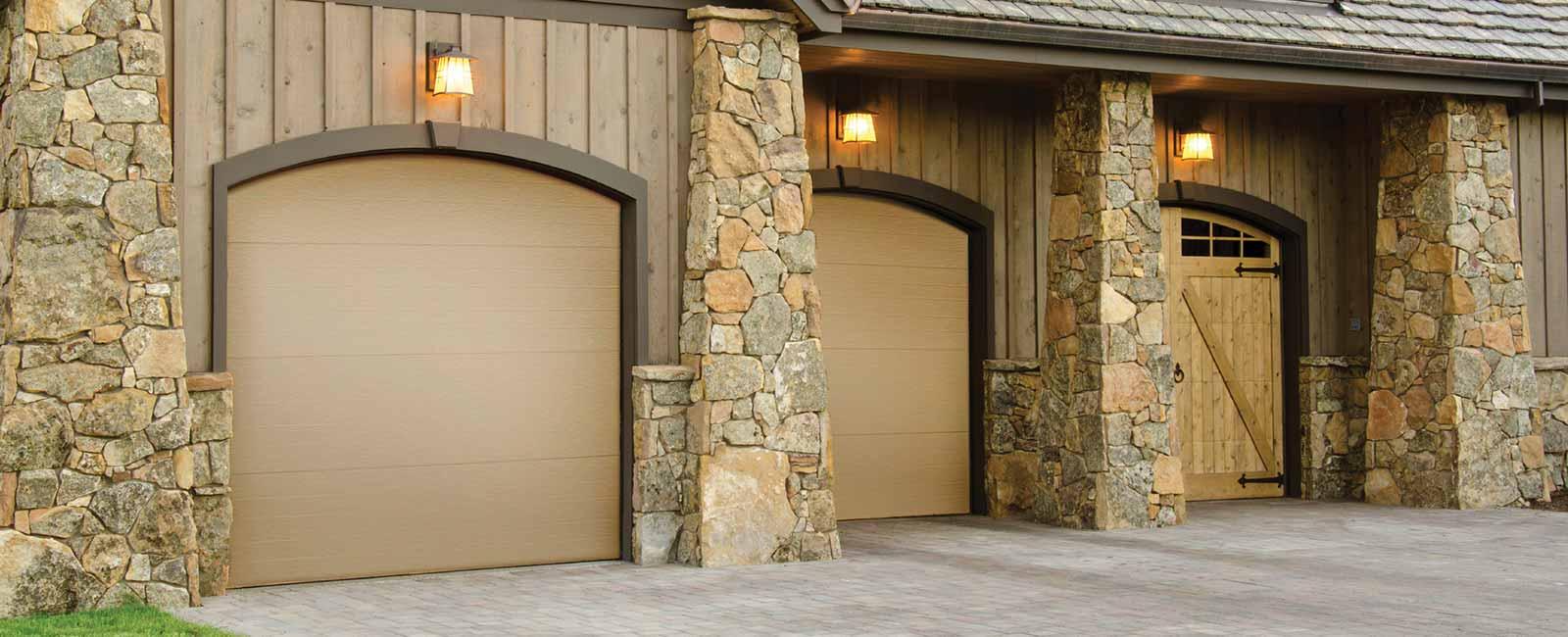 three single-car flush panel garage doors