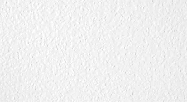 Closeup photo of Stucco door texture - white